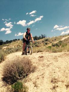 Adam riding the trails on his mountain bike!